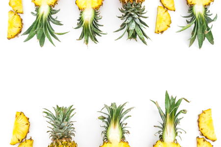 Food frame of juicy pineapple fruits on white background. Flat lay, top view. Food concept.