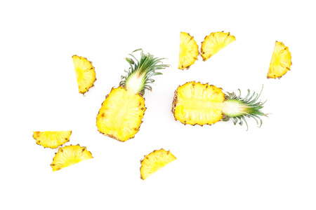 Tropical food concept. Sliced ??pineapple fruit isolated on white background. Flat lay, top view. Stock Photo
