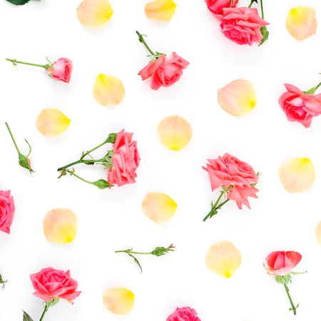 Floral pattern with roses flowers and petals on white background. Flat lay, top view.