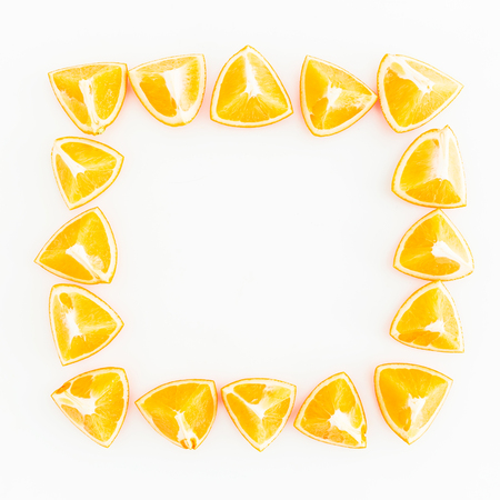 Food square frame of orange fruit on white background. Flat lay, top view