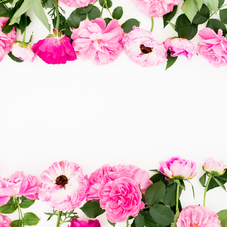 Frame with pink flowers on white background. Flat lay, Top view. Pastel flowers texture. Stock Photo