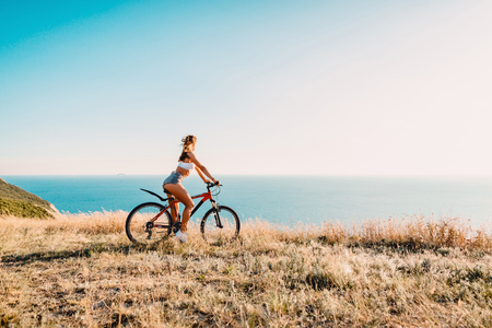 Young pretty woman with a mountain bicycle in outdoor