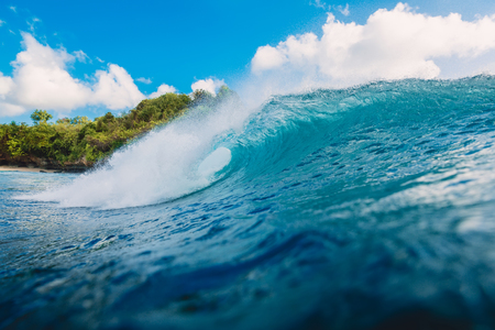 Blue barrel wave in the ocean. Wave and sky in Bali