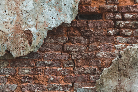 Brick wall with plaster background. Old vintage texture