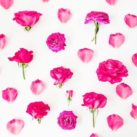 Background pink roses, petals and peonies on white. Flat lay, Top view. Stylish flowers texture. Stock Photo