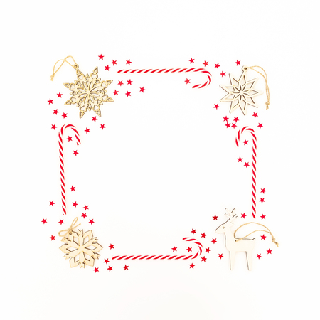 Christmas decoration, confetti and candy cane on white background. Flat lay, top view. New year concept