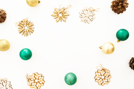 New Year composition. Christmas balls, wooden decorations on white background. Flat lay, top view