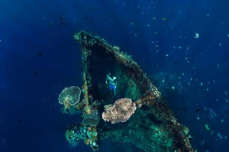 Freediver swim at USS Liberty Wreck, Bali