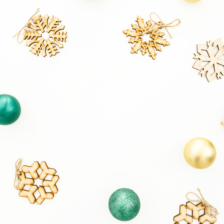 New Year composition. Frame of Christmas balls, wooden decorations on white background. Flat lay, top view Stock Photo