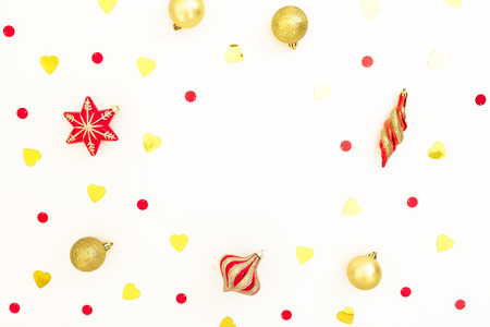 Christmas composition. Christmas golden and red balls on white background. Flat lay, top view