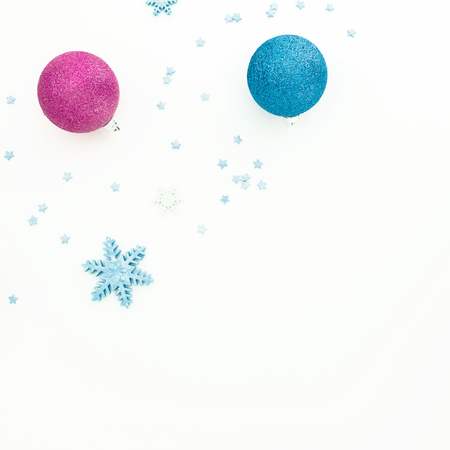 Creativity New Year composition. Christmas balls on white background. Flat lay, top view