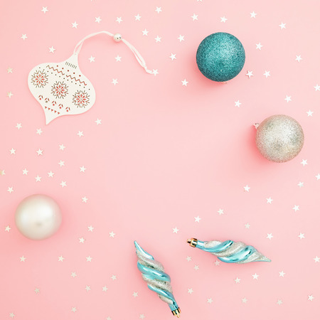 Christmas composition. Decoration and confetti on pink background. Flat lay, top view. Holidays concept