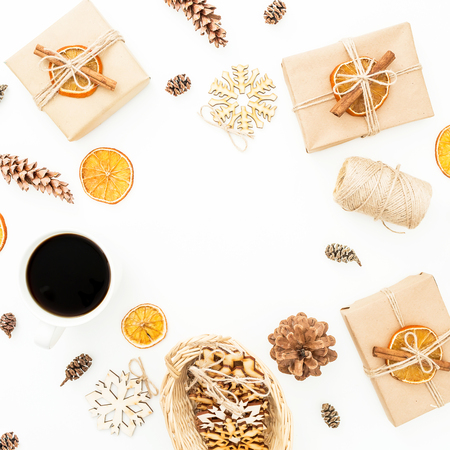 Christmas gift box, gift box, coffee cup and pine cones on white background. New year holiday. Flat lay, top view