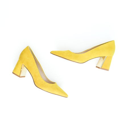 Women fashion background with yellow shoes on white. Flat lay, top view. Stock Photo