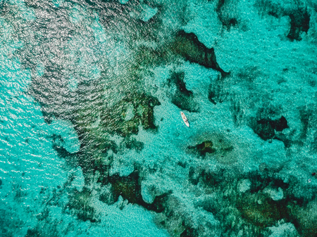 Turquoise ocean water and aerial drone shot. Top view