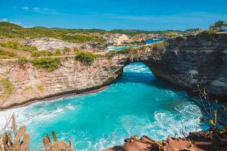 Broken bay in Nusa Penida, Bali, Indonesia. Blue sky and turquoise Water.