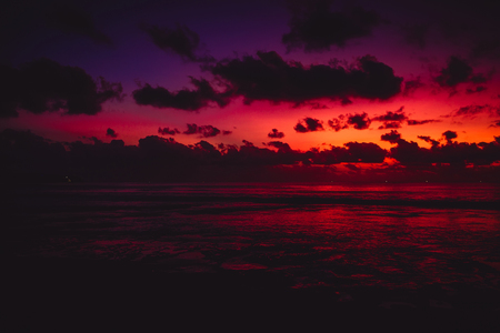 Colorful bright sunset or sunrise at beach with ocean Stock Photo