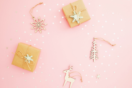 Christmas composition. Gift box, confetti on pink background. Flat lay, top view.