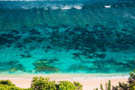 Tropical beach and blue ocean in tropical island Stock Photo