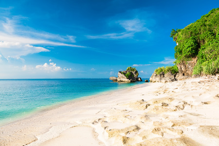 Tropical beach with blue ocean and sky in Bali