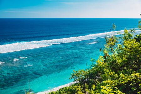Tropical beach and blue ocean water in tropical island Stock Photo