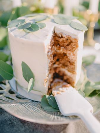 Wedding sweet cake with eucalyptus leaves. Wedding dinner