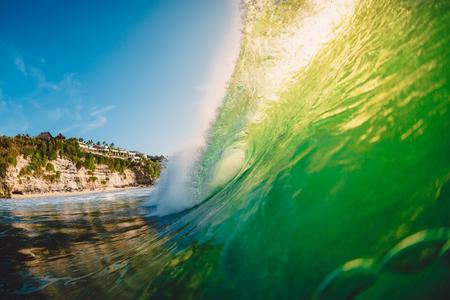 Big green wave in ocean. Breaking wave in Bali at Padang Padang