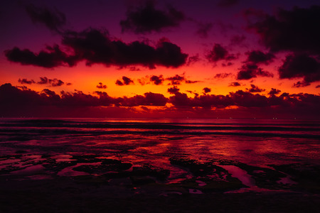 Ocean with waves and colorful sunset or sunrise in Bali. Archivio Fotografico