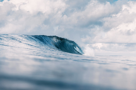Ocean barrel wave in ocean. Breaking wave for surfing in Tahiti Banco de Imagens