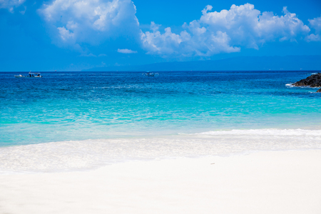 Tropical beach with sand and blue ocean in Maldives