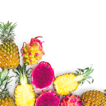 Pineapple, mango and dragon fruits on white background. Flat lay, top view. Tropical food concept.