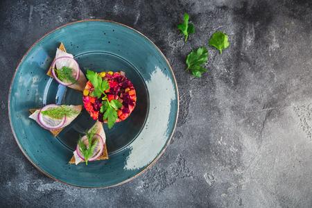 Homemade beetroot salad vinaigrette with fish.