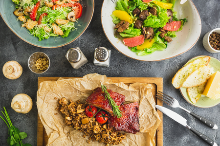 Barbecue meat with buckwheat, fresh salad with citrus and grilled liver Stock Photo