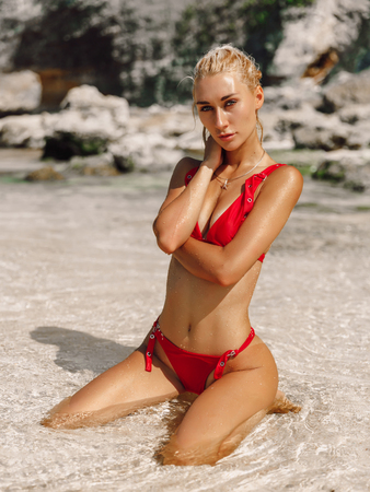 Attractive young woman in swimwear at ocean beach in Bali Stock Photo