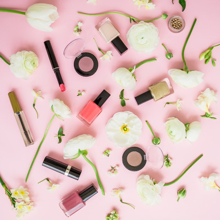 Blogger composition with flowers, cosmetics and accessory on pink background. Top view. Flat lay. Stock Photo