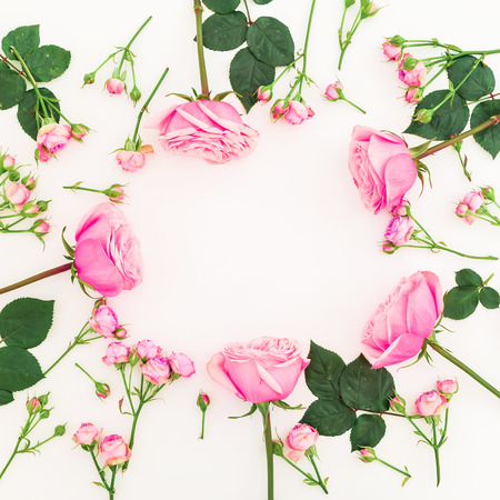 Floral frame with roses flowers isolated on white background. Flat lay, top view. Valentines day concept