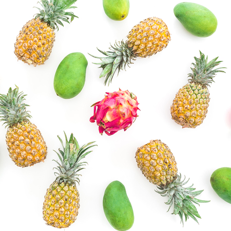 Pineapple, mango and dragon fruit on white background. Flat lay, top view.