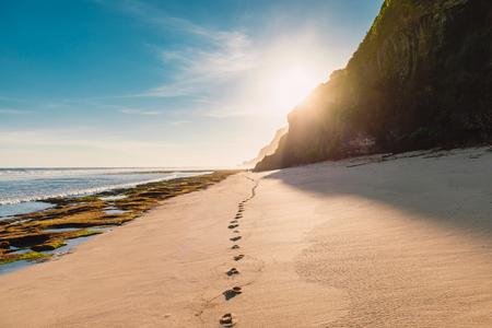 Tropical sandy beach with ocean, sky and sunshine in Bali