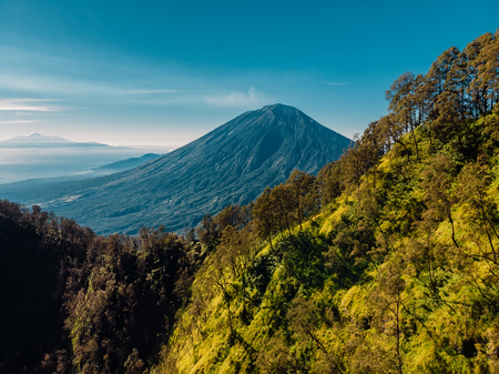 Aerial view of Agung volcano with forest in Bali
