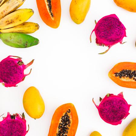 Fruits frame with banana, papaya, mango and dragon fruits on white background. Flat lay. Top view. Tropical fruit Reklamní fotografie