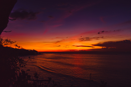 Bright sunset with ocean and waves in tropical island