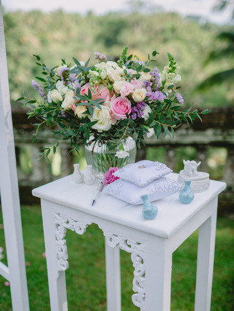 Wedding bouquet with blue gift. Wedding day with decor.