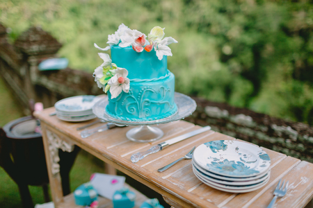 Wedding tasty cake with flowers and gifts. Wedding banquet