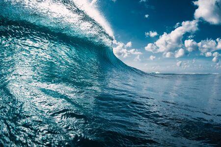 Blue barrel wave in ocean. Breaking crystal wave