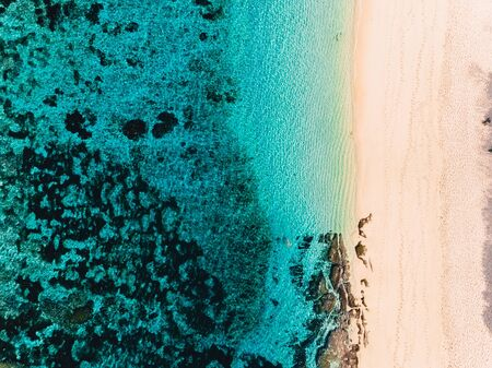 Aerial view of tropical beach and turquoise ocean. 写真素材