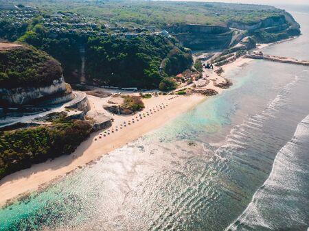 Beautiful coastline with turquoise ocean and sandy beach in Bali. Aerial view 写真素材