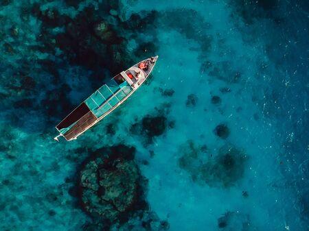 Tour boat in blue ocean near Gili island.