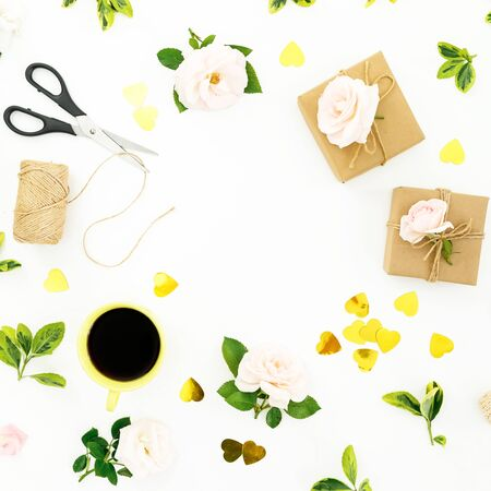 Frame composition with roses, gifts box, scissors and golden confetti on white 写真素材