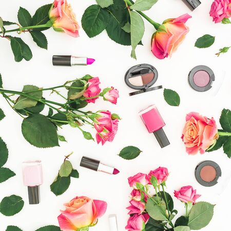 Beauty composition with roses flowers and make up cosmetics on white