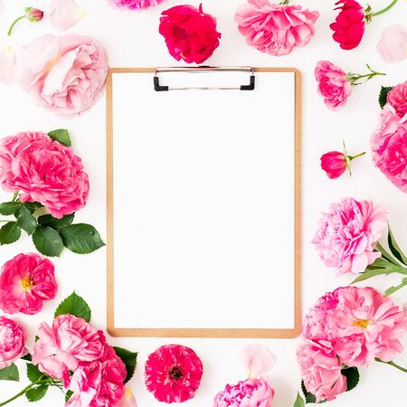 Floral frame of pink roses on white 写真素材